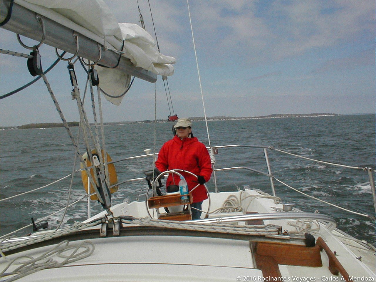The Admiral at the helm as we head out of Milford Harbor - perfect sailing weather!