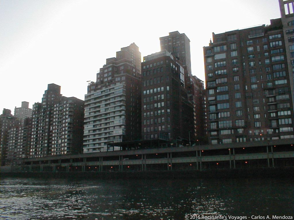 Entering the concrete canyon that is the East River...
